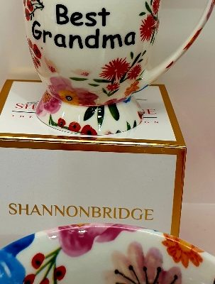 Shannonbridge Pottery vibrant floral mug with best grandma painted in black writting with a white base colour for the duchess style mug