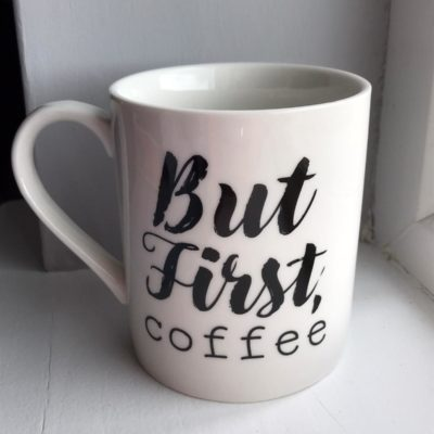 cream mug with but first coffee written in black