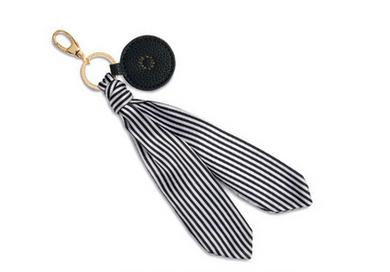 Scraf bag charm in black and white stripes