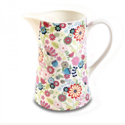 Shannonbridge white pottery milk jug with beautiful colourful Ditsy Flower design. Each bottle includes a cork. Ditsy Flower designs of blue, pink and raspberry flowers. Capacity 1 pint