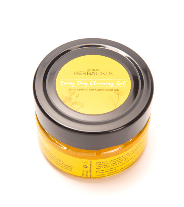 Everyday Cleansing Gel with apricot and carrot seed oils in a glass jar with yellow and black label.