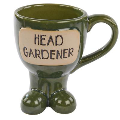 Green Head Gardener mug with feet