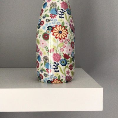 Shannonbridge white pottery milk bottle with beautiful colourful ditsy flower design. Each bottle includes a cork. Ditsy Flower design includes blue, pink and raspberry flowers