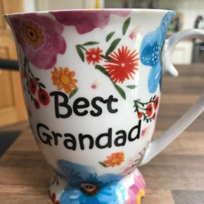 Shannonbridge Pottery vibrant floral mug with best grandad painted in black writting with a white base colour for the mug