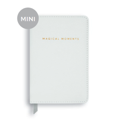Magical moments mini notebook. pearlesent white with magicalmoments written in gold on the front