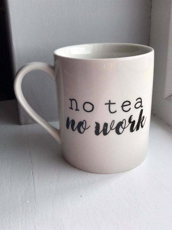 cream mug with no tea no work written in black writting