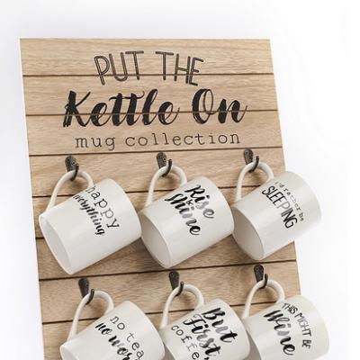 Assorted white mugs with black writting
