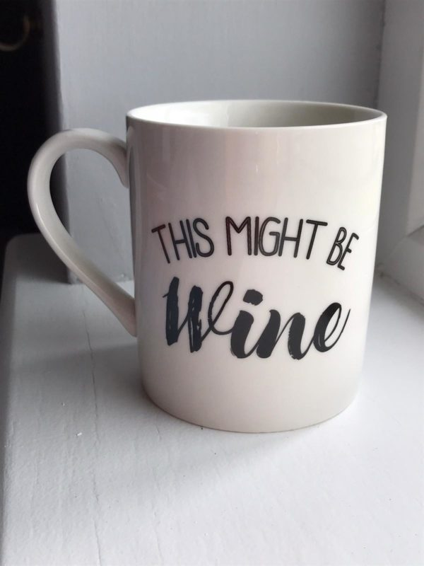 Cream mug with This might be wine in black