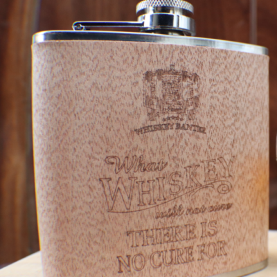 "6oz capacity stanless steel inner casing. RusTech Wood exterior with  whiskey banter wording: ""What Whiskey will not cure - there is no cure for"""