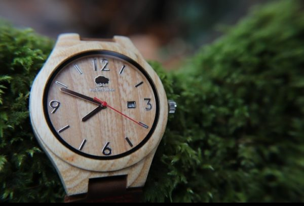 Ash Wooden face watch with black numbering detail. Brown leather strap with red stitching detail