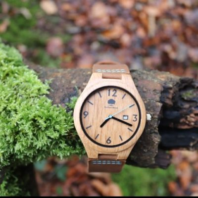 Oak Wooden face watch with black numbering detail. Brown leather strap with blue stitching detail