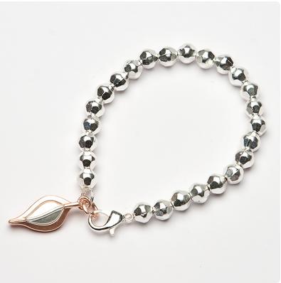 Stretch beaded bracelet with 2 tone leaf charm
