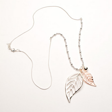 Twin leaf necklace on long chain