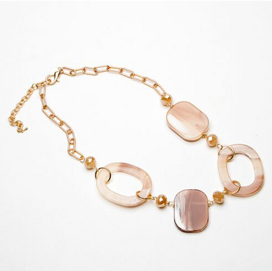 Short pink resin necklace with ovals and discs on a gold effect chain