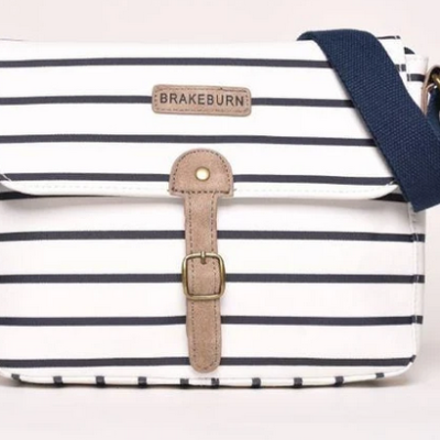 Brakeburn Stripped saddle bag. White base colour with navy thin stripes. Navy strap and brown buckle