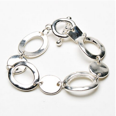 Loop & disc metal bracelet with T-Bar fastening