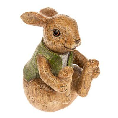 Resin figurine of benjamin bunny sitting. Brown bunny with green waist coat