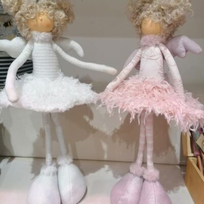 pink and white standing dolls with feathered skirts