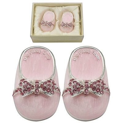 Slver plates pink baby shoes tooth and curl