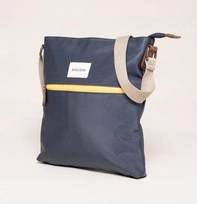 Navy cross body handbag with yellow zip detail